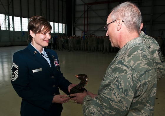 U.S. Air Force Senior Master Sgt. Julie Murray accepts the Richard L. Boggs Leadership Award at an awards formation, Rickenbacker Air National Guard Base, Ohio, Dec. 13, 2014. (U.S. Air National Guard photo by Tech. Sgt. Zachary Wintgens/Released)