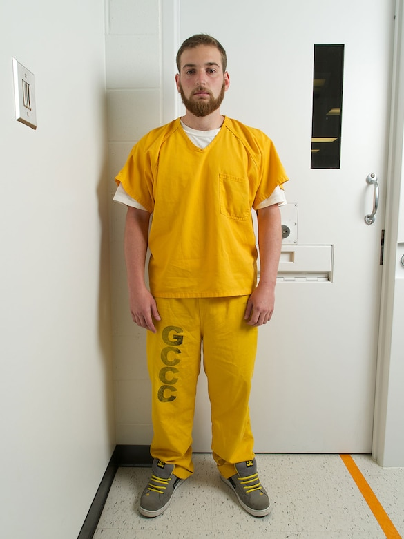"Former Airman 1st Class Lane Wyatt stands in an interview room at Goose Creek Correctional Center Aug. 7, 2014. Wyatt described the months since killing Citari Townes-Sweatt in a June 30, 2013, drunk-driving accident as ""my own personal hell."" (U.S. Air Force photo/David Bedard)"