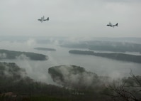 A C-130H Hercules and C-130J Super Hercules participate in an interfly formation flight Dec. 23, 2014, near Pinnacle Mountain State Park in Roland, Ark. The C-130J and C-130H normally fly in separate formations to maximize the performance potential of both aircraft types, but can be employed together in an interfly formation if necessary. (U.S. Air Force photo/Airman 1st Class Scott Poe)