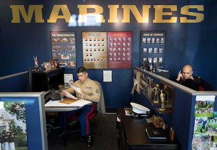 LYNWOOD, Wa.-- Sgt. Ricardo Schebesta (left) and Staff Sgt. Bryson Twigg, Marine recruiters in Lynnwood and Everett, Washington, process paperwork and call potential applicants in their Lynnwood recruiting office Jan. 7, 2015. After hearing shouting and honking outside their office Jan. 6, Schebesta, Twigg and Staff Sgt. Ben Shoemaker responded to a situation in which two young men attempted to rob an elderly woman. Despite being told by the victim the suspects were armed with a gun, the Marines ran through rush-hour traffic to pursue them. Shoemaker subdued one of the suspects using a wrist lock, a technique taught in the Marine Corps Martial Arts Program, and held the suspect until police arrived to arrest him. Police retrieved a metal bat from the suspect's pants but have not yet located his accomplice. Schebesta is from Anaheim, California. Shoemaker is from Spokane, Washington. Twigg is from Akron, Ohio. (U.S. Marine Corps photo by Sgt. Reece Lodder)