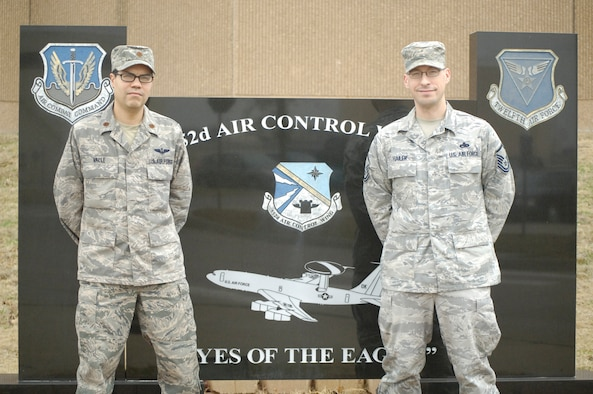 Maj. Miguel Valle III, left, and Master Sgt. Randy Hailer, members of the 552nd Air Control Wing's Plans and Programs office, were recently lauded along with Maj. Jason Nelson, with the 2014 Air Combat Command OPSEC Organization Team of the Year Award. Sergeant Hailer also won the ACC OPSEC NCO of the Year Award and will compete for the Air Force-level award to be announced next month. (Air Force photo by Darren D. Heusel)