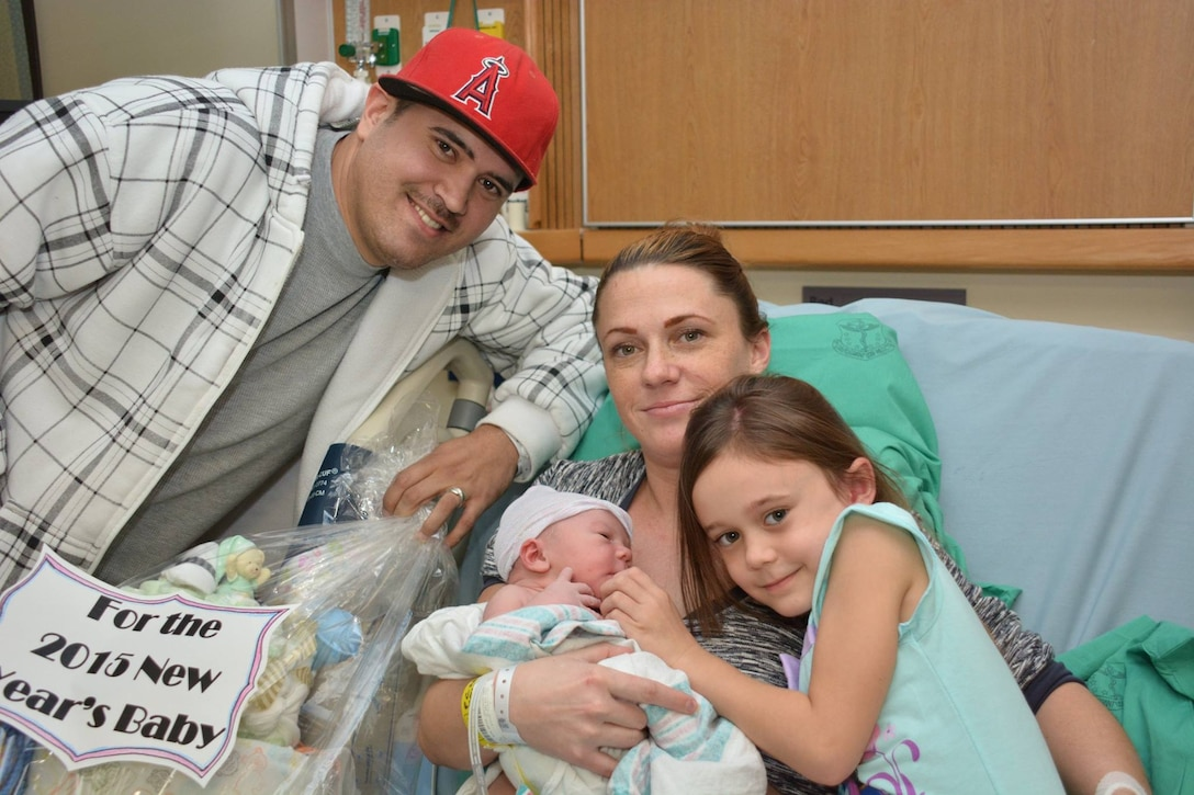 The Kelly family poses for a photo with their newborn Jan. 2, 2015, at David Grant USAF Medical Center on Travis Air Force Base, Calif. Royce Kelly was the first baby born at Travis in 2015 to father Staff Sgt. Shane Kelly, 60th Security Forces Squadron combat arms instructor, mother Crystal Kelly and sister Leilani Kelly. (U.S. Air Force photo by Staff Sgt. Christopher Carranza)