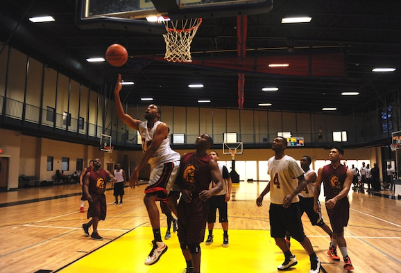 Otis James, a 19th Logistics Readiness Squadron Team 1 player, attempts a layup Jan. 5, 2015, at Little Rock Air Force Base, Ark., during a pre-season intraumural basketball game. The 19th LRS lost to the 19th Medical Group Team 1 by 16 points. (U.S. Air Force photo by Senior Airman Stephanie Serrano)