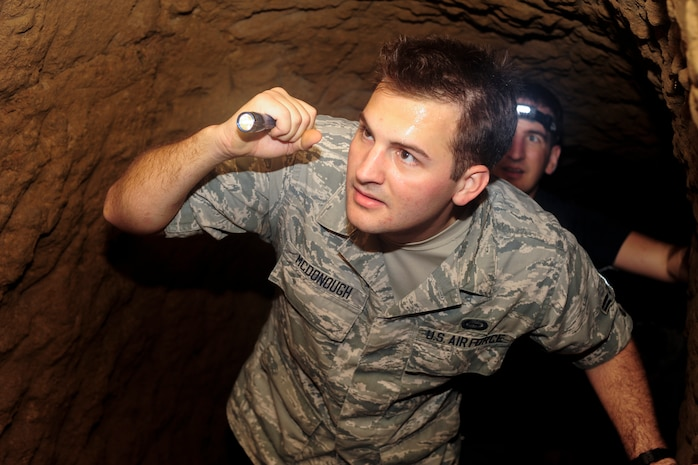 Airman 1st Class Sean McDonough, 390th Intelligence Squadron signal intelligence analyst, explores a cave that was used by Japanese troops during the battle of Iwo Jima, Jan. 8, 2015, at Iwo To, Japan. Japanese forces dug more than 7 miles of interconnected tunnels and used them as a primary defense against the Americans. (U.S. Air Force photo by Airman 1st Class John Linzmeier)