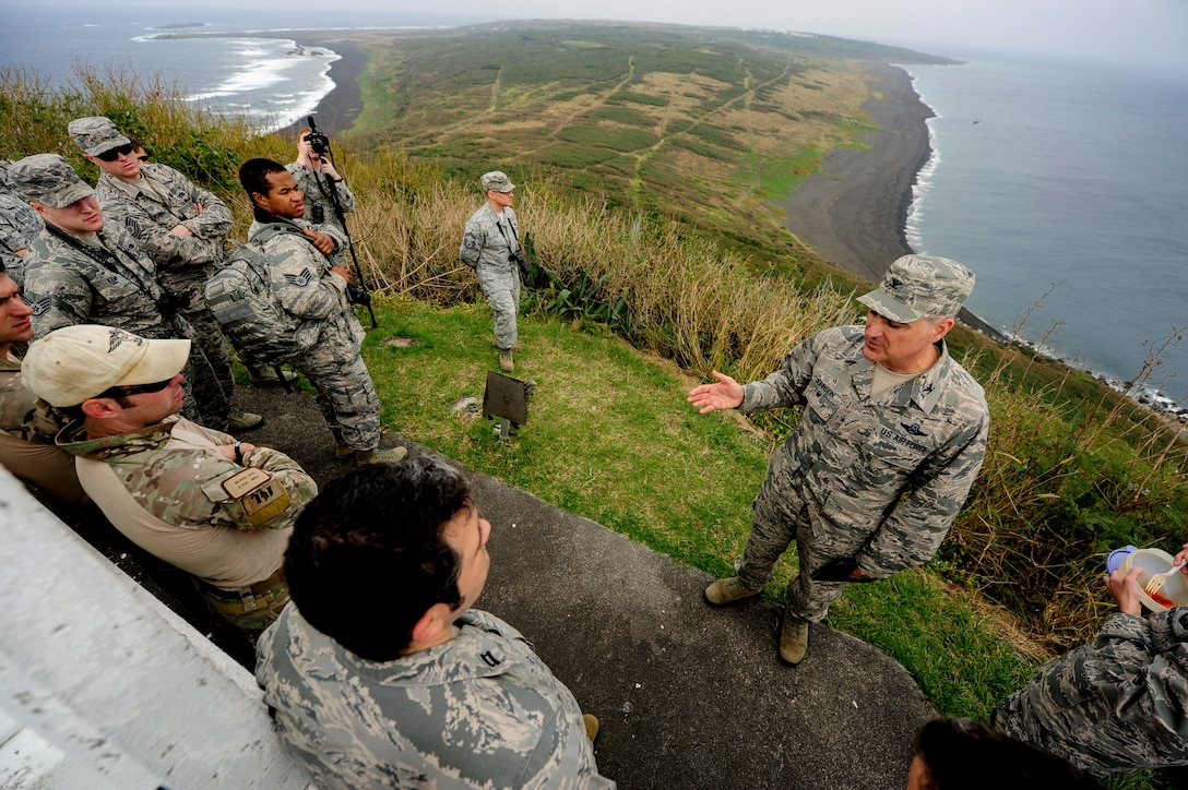 U.S Air Force Col. Paul Johnson, 18th Operations Group commander, delivers a history lesson on top of Mount Suribachi, Jan. 8, 2015, on Iwo To, Japan. He led a group of 32 Airmen from Kadena Air Base, Japan, on a tour through the Island, stopping at various historic sites to educate and pay respect to the U.S. Marines who lost their lives at the battle of Iwo Jima. (U.S. Air Force photo by Airman 1st Class John Linzmeier)