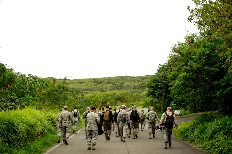 Airmen from Kadena Air Base, Japan, embark on a hike toward Mount Suribachi, Jan. 8, 2015, on Iwo To, Japan.  The Airmen arrived on an aircraft that conducted a training mission to the island. They hiked approximately 10 miles through the south side of the island to pay homage to the fallen heroes of Iwo Jima. (U.S. Air Force photo by Airman 1st Class John Linzmeier)