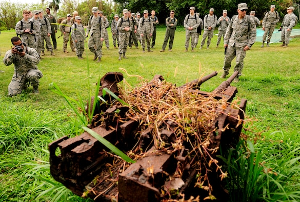 Airmen from Kadena Air Base, Japan, gather around a rusted Type 96 Imperial Japanese Navy 25mm dual-purpose anti-tank/anti-aircraft gun Jan. 8, 2015, on Iwo To, Japan. The island was previously known as Iwo Jima and was the battleground of the largest assault in U.S. Marine Corps history, lasting 36 days and having more than 26,000 Japanese and American casualties. The Airmen traveled on an aircraft conducting a training mission with Iwo To enroute. (U.S. Air Force photo by Airman 1st Class John Linzmeier)