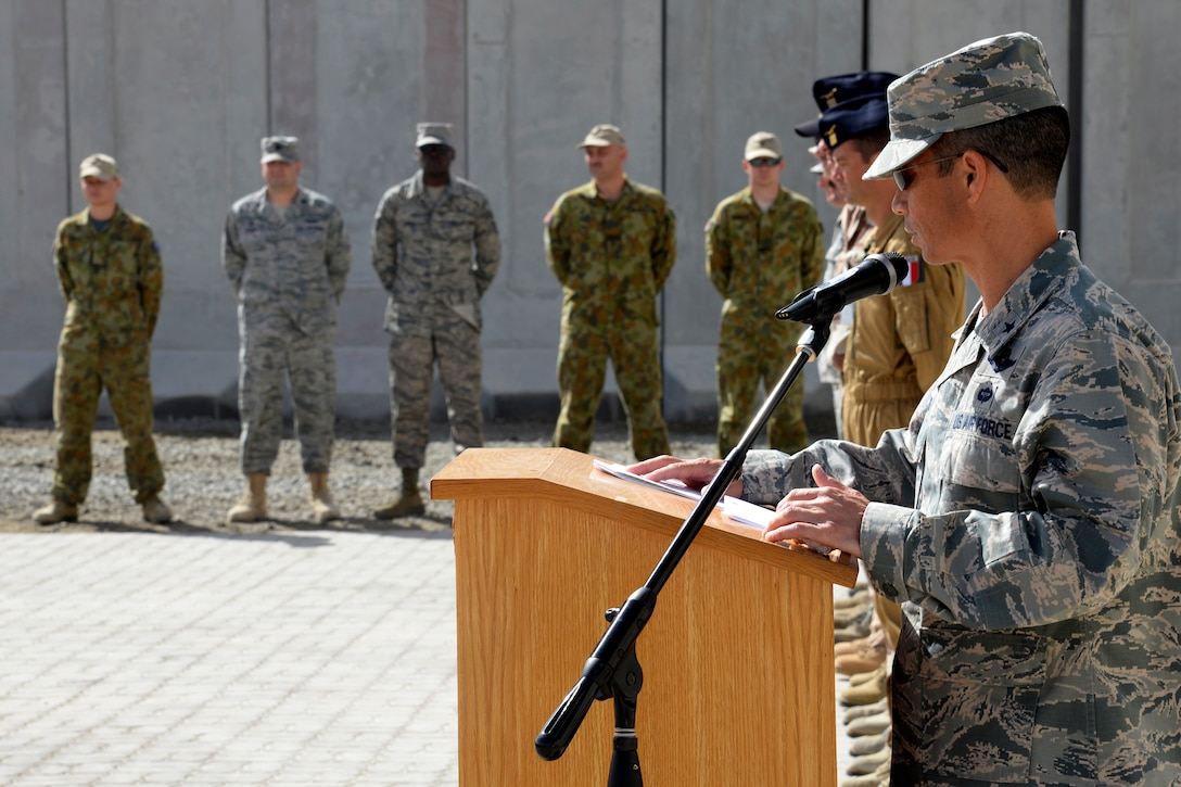 Brig. Gen. John Quintas, 380th Air Expeditionary Wing commander, speaks during the Remembrance Day ceremony here Nov. 9. During the ceremony the 'Last Post' was played followed by two minutes of silence and reveille. (U.S. Air Force photo/Tech. Sgt. Marie Brown)