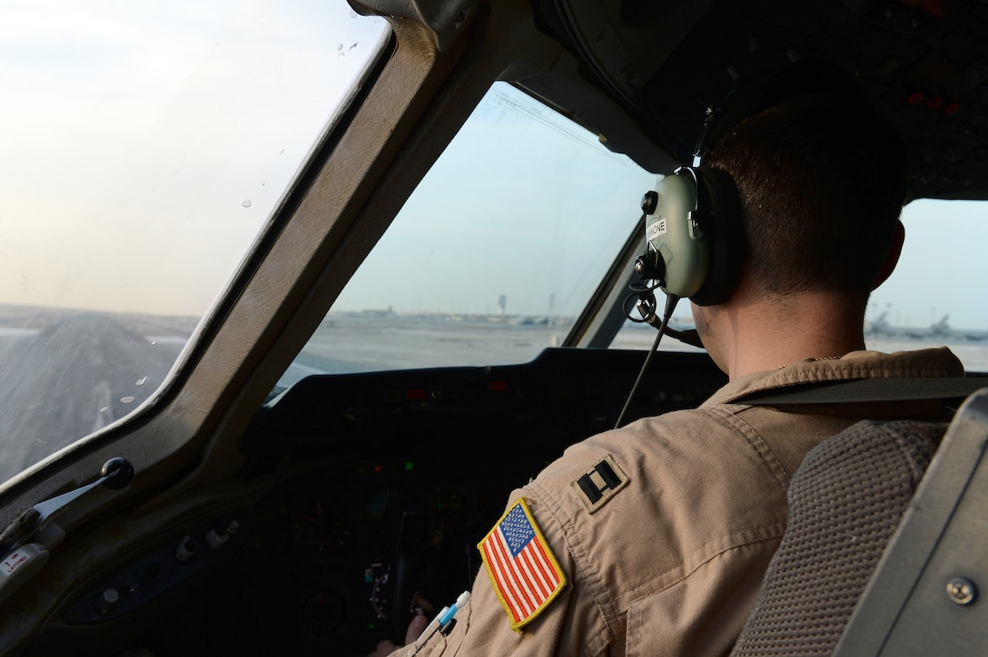 Capt. Michael, Expeditionary Air Refueling Squadron pilot, prepares to take-off in a KC-10 Extender on an air refueling mission in support of Opeation Inherent Resolve at an undisclosed location in Southwest Asia Nov. 15, 2014. The KC-10 Extender is one of the few jet aircraft in the world configured to haul military cargo, conduct aerial refueling missions and transport personnel at the same time. (U.S. Air Force photo/Tech. Sgt. Marie Brown)