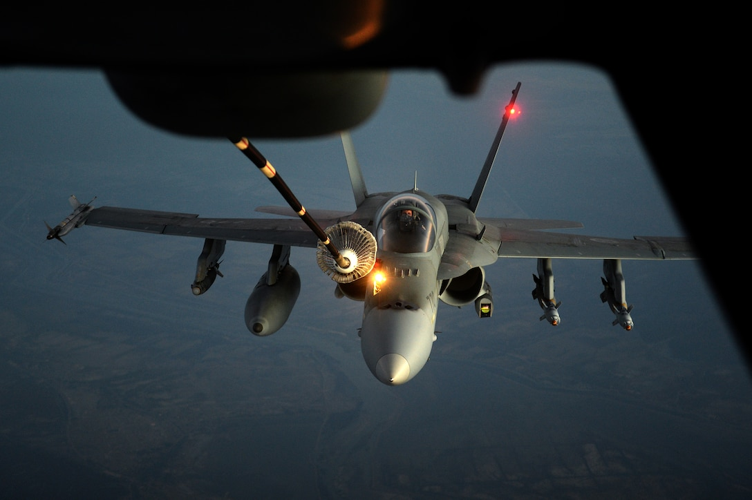A Canadian F-18 Hornet approaches a KC-10 Extender drogue centerline refueling system during an inflight refueling mission over the skies of Iraq in support of Operation Inherent Resolve Nov. 15, 2014. The KC-10 can refuel a wide variety of U.S. and allied military aircraft within the same mission. During boom refueling operations, fuel is transferred to the receiver at a maximum rate of 1,100 gallons (4,180 liters) per minute; the hose and drogue refueling maximum rate is 470 gallons (1,786 liters) per minute. (U.S. Air Force photo/Tech. Sgt. Marie Brown)