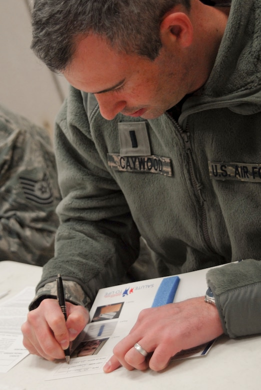 U.S. Air Force Chaplain, 1st Lt. Robert Caywood, a chaplain with the 180th Fighter Wing, filled out a consent form during the wing's two-day bone marrow registration drive Jan. 10 2015, part of the Salute to Life Program. The Salute to Life Program, also known as the C.W. Bill Young/Department of Defense Marrow Donor Program, works with active duty and their dependents, guard, reservist and Department of Defense civilian employees to facilitate marrow and stem cell donations. All of the donors are volunteers and since the program inception in 1991, more than 750,000 individuals to fight against blood cancer and other fatal diseases.  Air National Guard photo by Senior Master Sgt. Beth Holliker (Released)