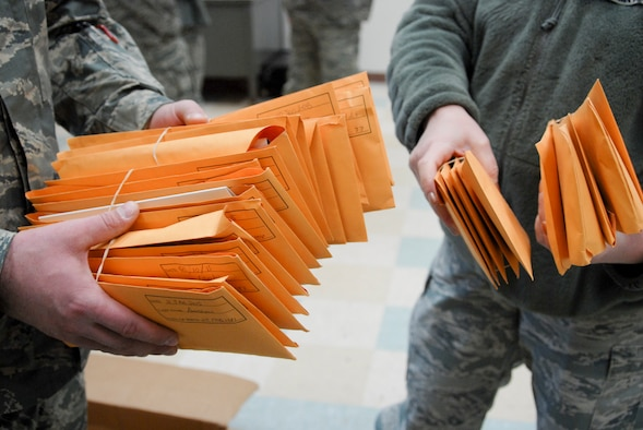 U.S. Air Force Airmen from the 180th Fighter Wing prepare over 30-plus registration packages to send to Salute to Life Program to join the national registry of volunteer bone marrow donors during the wing's two-day bone marrow registration drive Jan. 10 2015. The Airmen volunteered to complete consent forms and a swab of the inside of their cheek as part of the Salute to Life Program. The Salute to Life Program, also known as the C.W. Bill Young/Department of Defense Marrow Donor Program, works with active duty and their dependents, guard, reservist and Department of Defense civilian employees to facilitate marrow and stem cell donations. All of the donors are volunteers and since the program inception in 1991, more than 750,000 individuals to fight against blood cancer and other fatal diseases.  Air National Guard photo by Senior Master Sgt. Beth Holliker (Released)