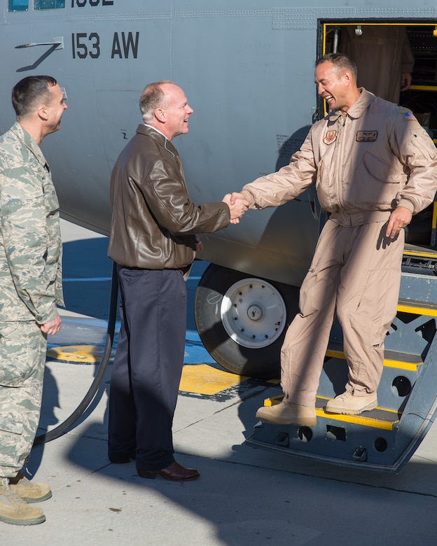 Wyoming Governor Matt Mead and Wyoming Air National Guard Chief of Staff Brig. Gen. Stephen Rader welcome Lt. Col. Dayton Kobayashi home Jan. 8, 2015 at Cheyenne Air National Guard Base in Cheyenne, Wyoming. Around 60 members of the 153rd Airlift Wing, Wyoming Air National Guard, returned home this week following a two-month deployment to Southwest Asia.