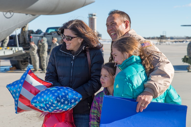 Family members welcome home U.S. Air Force Airmen from the 153rd Airlift Wing, Wyoming Air National Guard Jan. 8, 2015 at Cheyenne Air National Guard Base in Cheyenne, Wyoming. Around 60 members of the 153rd Airlift Wing, Wyoming Air National Guard, returned home this week following a two-month deployment to Southwest Asia