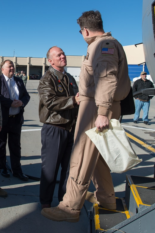 Wyoming Governor Matt Mead welcomes home Lt. Col. Mark Schmidt Jan. 8, 2015 at Cheyenne Air National Guard Base in Cheyenne, Wyoming. Around 60 members of the 153rd Airlift Wing, Wyoming Air National Guard, returned home this week following a two-month deployment to Southwest Asia.