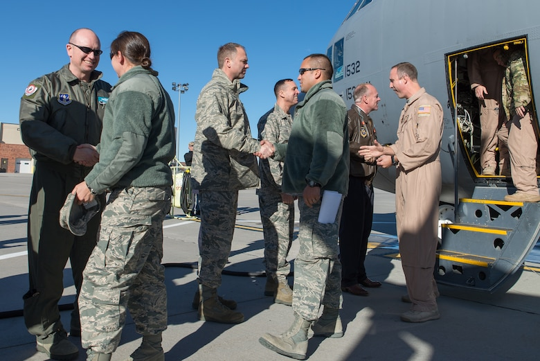 Wyoming Governor Matt Mead and Wyoming Air National Guard leaders welcome home members from the 153rd Airlift Wing, Wyoming Air National Guard Jan. 8, 2015 at Cheyenne Air National Guard Base in Cheyenne, Wyoming. Around 60 members of the 153rd Airlift Wing, Wyoming Air National Guard, returned home this week following a two-month deployment to Southwest Asia
