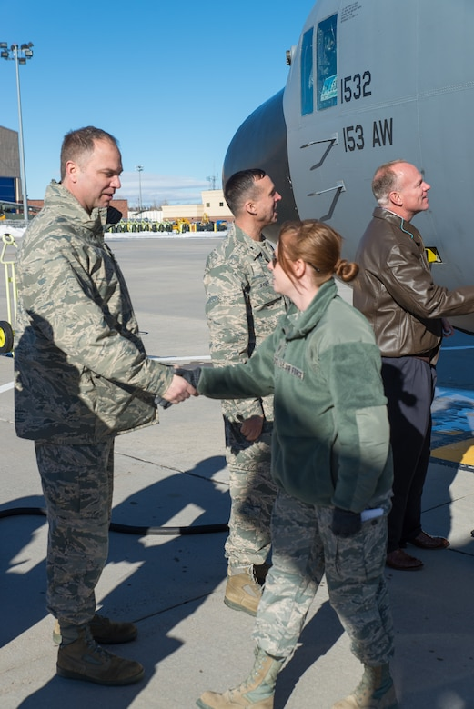 153rd Airlift Wing Commander Col. Bradley Swanson welcomes home Staff Sgt. Chelsea Nelson Jan. 8, 2015 at Cheyenne Air National Guard Base in Cheyenne, Wyoming. Around 60 members of the 153rd Airlift Wing, Wyoming Air National Guard, returned home this week following a two-month deployment to Southwest Asia