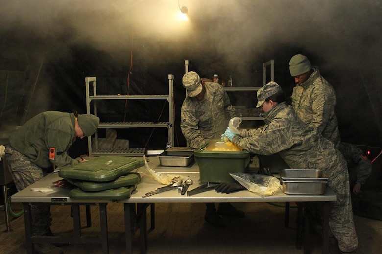 Dobbins Air Reserve Base, Ga. – Services Airmen of the 166th Forces Support Squadron, Delaware Air National Guard, prepare a meal in the Single Pallet Expeditionary Kitchen on Nov. 20 during Force Support Combat Training conducted here Nov. 14-21, 2014. (U.S. Air National Guard photo by Staff Sgt. Brian Ford)