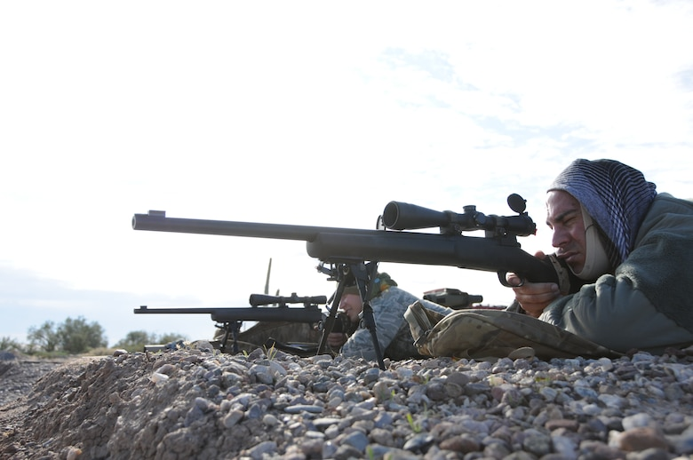 """Staff Sgt. Robert Ehle, 161st Security Forces Squadron Advanced Designated Marksmen, hones his newly acquired skills at the shooting range in Florence, Ariz., Jan. 9, 2015. ADM Airmen, or """"snipers"""", deliver long-range direct fire out to 600 meters and provide enhanced situational awareness through observation and reporting in peacetime and contingency operations. The 161st Security Forces Squadron is one of only eight units of the more than 100 Air National Guard units which currently have trained/qualified advanced designated marksmen. To become a certified Air Force advanced designated marksman, Airmen must attend the ADM course at Ft. Bliss, El Paso, Texas. The 11-day course familiarizes Airmen with the M24 weapon system and teaches target detection, along with distance and windage estimation. """"The hardest part of the school is the really long days,"""" said Ehle. """"It's out in the desert, there's no shade and it's about 110 degrees and you are out there for more than eight hours."""" (U.S. Air National Guard photo by Tech. Sgt. Courtney Enos/Released)"""
