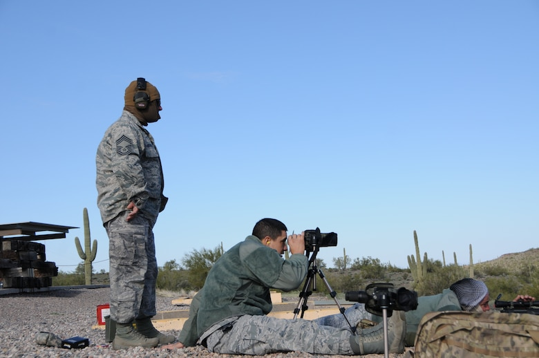 "(From left to right) Chief Master Sgt. Emilio Rodriguez, Tech. Sgt. Frank Calzadillas and Staff Sgt. Robert Ehle, Advanced Designated Marksmen from the 161st Security Forces Squadron, hone their newly acquired skills at the shooting range in Florence, Ariz., Jan. 9, 2015. ADM Airmen, or ""snipers"", deliver long-range direct fire out to 600 meters and provide enhanced situational awareness through observation and reporting in peacetime and contingency operations. The 161st Security Forces Squadron is one of only eight units of the more than 100 Air National Guard units which currently have trained/qualified advanced designated marksmen. To become a certified Air Force advanced designated marksman, Airmen must attend the ADM course at Ft. Bliss, El Paso, Texas. The 11-day course familiarizes Airmen with the M24 weapon system and teaches target detection, along with distance and windage estimation. (U.S. Air National Guard photo by Tech. Sgt. Courtney Enos/Released)"