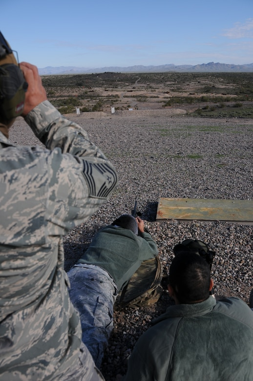"(From left to right) Chief Master Sgt. Emilio Rodriguez, Staff Sgt. Robert Ehle, and Tech. Sgt. Frank Calzadillas, Advanced Designated Marksmen from the 161st Security Forces Squadron, hone their newly acquired skills at the shooting range in Florence, Ariz., Jan. 9, 2015. ADM Airmen, or ""snipers"", deliver long-range direct fire out to 600 meters and provide enhanced situational awareness through observation and reporting in peacetime and contingency operations. The 161st Security Forces Squadron is one of only eight units of the more than 100 Air National Guard units which currently have trained/qualified advanced designated marksmen. To become a certified Air Force advanced designated marksman, Airmen must attend the ADM course at Ft. Bliss, El Paso, Texas. The 11-day course familiarizes Airmen with the M24 weapon system and teaches target detection, along with distance and windage estimation. (U.S. Air National Guard photo by Tech. Sgt. Courtney Enos/Released)"