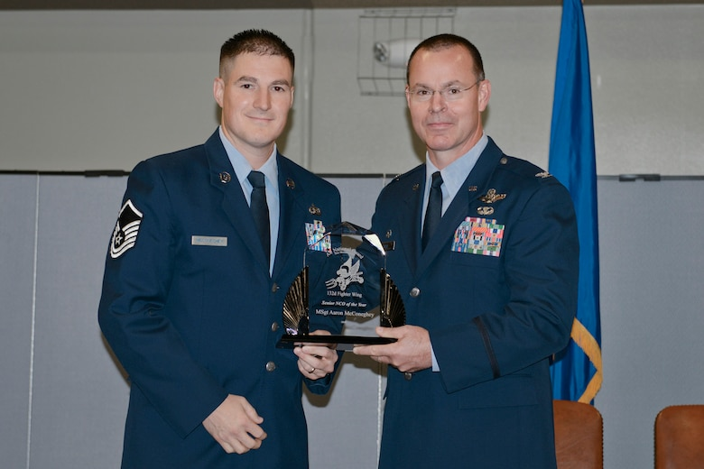 Col. Kevin Heer (right), Commander, 132nd Fighter Wing (132FW), Des Moines, Iowa, presents Master Sgt. Aaron McConeghey (left) with the 132FW Senior NCO of the Year award at the 2014 Annual Awards Ceremony held at the Valley Community Center, West Des Moines, Iowa on Saturday, November 1, 2014.  Master Sgt. McConeghey has since been selected as the 2015 Iowa ANG Outstanding Senior NCO of the Year.  (U.S. Air National Guard photo by Staff Sgt. Linda K. Burger/Released)