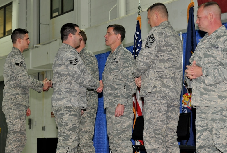 Maj. Gen. Verle Johnston, Col. Greg Semmel, Command Chief Master Sgt. Richard King and Command Chief Master Sgt. Russell Youngs congratulate members of Hancock Field during the Hometown Heroes ceremony January 10, 2015. The ceremony was held to recognize Airmen who mobilized and supported contingency operations for 31 or more consecutive days either serving overseas or here in the U.S. since Sept. 11, 2001. (U.S. Air National Guard photo by Senior Airman Duane Morgan/Released)