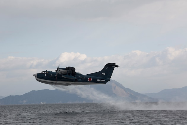 A Japan Maritime Self-Defense Force ShinMaywa US-2 takes flight after an amphibious landing during the JMSDF Fleet Air Wing 31's first flight training of the year aboard Marine Corps Air Station Iwakuni, Japan, Jan. 7, 2015. In the Japanese culture they believe a successful first flight brings good fortune for the rest of the year.