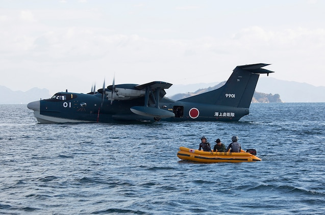 The Japan Maritime Self-Defense Force conducted their first flight training of the year aboard Marine Corps Air Station Iwakuni, Japan, Jan. 7, 2015. The training included: a beginning ceremony, taking flight, amphibious landing and water rescue.