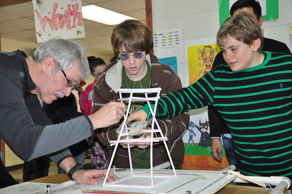 Doug Bliss (left), geotechnical and environmental engineering branch chief at the Far East District, helps Tristen Henley (center) and Jack Donoghe, eight grade students at Seoul American Middle School, during the earthquake tower challenge Jan. 9.
