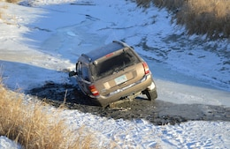 """A vehicle breaks through the ice on the Missouri River in North Dakota. The driver escaped safely however driving on the ice must fall within Title 36 Regulations. The practice of """"ice driving"""" or """"ice racing"""" is prohibited and extremely dangerous."""