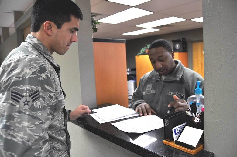 Master Sgt. Ken DuPree (right) helps a customer at the new customer service area inside the Wing headquarters building at the Nevada Air National Guard base in Reno.  USAF photo by Tech. Sgt. Rebecca Palmer RELEASED.