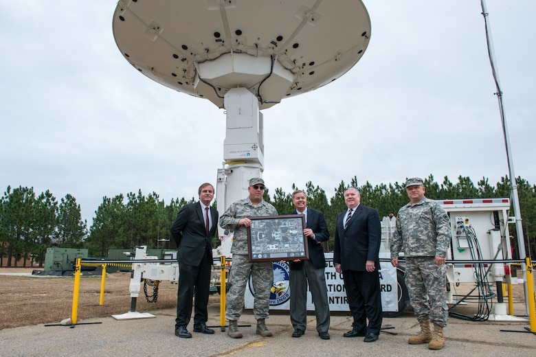 U.S. Senator Lindsey Graham is presented with a satellite image of the U.S. Capitol building by Eagle Vision 4 personnel assigned to the 169th Communications Flight at McEntire Joint National Guard Base, S.C. Jan. 11, 2015. Graham was the guest speaker during the ribbon cutting and inauguration of the Eagle Vision unit at the base. The unit will maintain a deployable commercial satellite imagery system ready to support contingency operations and disaster relief efforts.  (U.S. Air National Guard photo by Tech. Sgt. Jorge Intriago/Released)