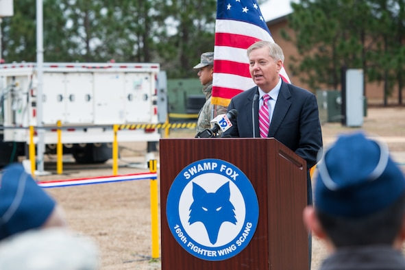 U.S. Senator Lindsey Graham speaks during the ribbon cutting ceremony of Eagle Vision 4 at McEntire Joint National Guard Base, S.C. Jan. 11, 2015. Graham was the guest speaker during the inauguration of the Eagle Vision unit at the base. The unit will maintain a deployable commercial satellite imagery system ready to support contingency operations and disaster relief efforts. (U.S. Air National Guard photo by Tech. Sgt. Jorge Intriago/Released)
