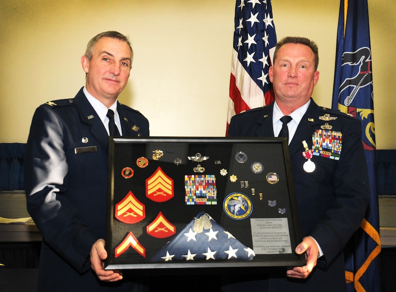 "The 111th Attack Wing Commander Col. Howard L. ""Chip"" Eissler presents a shadowbox to Lt. Col. (ret.) Scott ""Spartacus"" Hreso, former 111th ATKW chief of safety, during his retirement ceremony Jan. 10, 2015 in the wing headquarters building at Horsham Air Guard Station, Pa. The shadowbox represents Hreso's 36-year long career with military service spanning time in both the Marine Corps and Air National Guard. (U.S. Air National Guard photo by Staff Sgt. Michael Shaffer)"