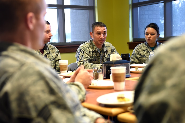 Chief Master Sgt. Brian Kruzelnick, 460th Space Wing command chief, takes notes during a breakfast with Airmen and the 460th SW commander, Col. John Wagner, Jan. 9, 2015, at the Panther Den on Buckley Air Force Base, Colo. During the breakfast, leadership sought out Airmen's thoughts and opinions on what they could do to make Buckley the best base in the Air Force. (U.S. Air Force photo by Airman 1st Class Emily E. Amyotte/Released)