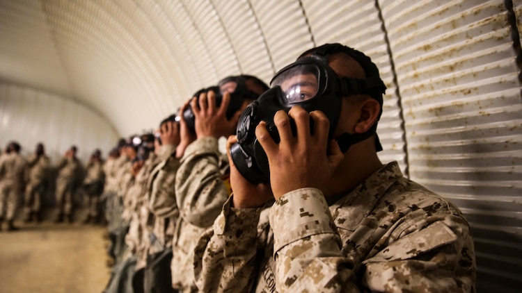 Recruits of Golf Company, 2nd Recruit Training Battaliom, endure the effects of chlorobenzylidene malonitrile, or CS gas, a non-lethal tear gas and riot control agent at Weapons and Field Training Battalion, Marine Corps Base Camp Pendleton Calif., Dec. 8.Recruits were required to perform three exercises while in the chamber. They shake their heads to demonstrate a correct seal of the mask, they conduct jumping jacks to elevate their heart rates, and finally are required to break the seal of the mask to expose their faces to the gas.