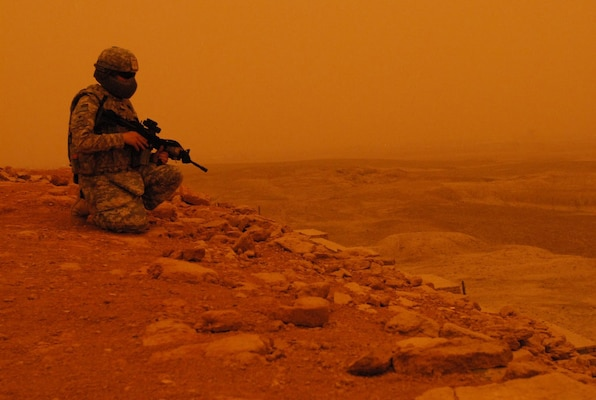Dusty skies set in as a lone Virginia National Guard Soldier from 1st Battalion, 116th Infantry Regiment, headquartered in Lynchburg, Va., looks down across a valley from the Ziggurat of Ur near the Tallil Airbase in Iraq. The 1/116th is currently deployed with the Louisiana National Guard's 256th Infantry Brigade Combat Team, 13th Sustainment Command (Expeditionary) in support of Operation Iraqi Freedom.
