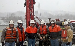 Pictured on the lock wall are left to right: Andy Harkness, INDC Deputy Chief; Kevin Gabig, district quality assurance; Mark Jones, district Engineering and Construction Division chief; Paul Surace,  district structural regional technical specialist; Brian McFarland, district lead engineer; and Dennis Zeveney,  district Dam and Levee Branch chief.