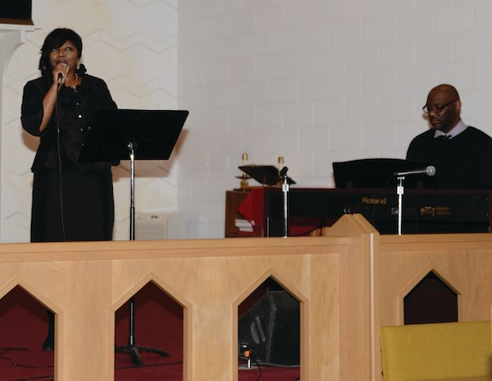 Jackie Johnson, a member of Marine Corps Logistics Command, honors Dr. Martin Luther King Jr. with her singing during Marine Corps Logistics Base Albany's observance of the late civil rights leader's birthday.