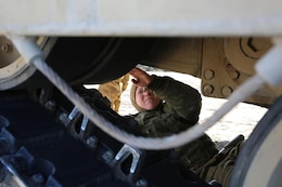 Sgt. Michelle A. Svec, tank crewman with Tank Platoon, Company B, Ground Combat Element Integrated Task Force, prepares to tighten track pads on the M1A1 Abrams tank during vehicle maintenance at Range SR-10, Marine Corps Base Camp Lejeune, North Carolina, Jan. 9, 2015. Marines with Tank Platoon conducted offensive and defensive engagements to prepare for an upcoming assessment at Marine Corps Air Ground Combat Center Twentynine Palms, California. From October 2014 to July 2015, the GCEITF will conduct individual and collective level skills training in designated ground combat arms occupational specialties in order to facilitate the standards based assessment of the physical performance of Marines in a simulated operating environment performing specific ground combat arms tasks. (U.S. Marine Corps photo by Sgt. Alicia R. Leaders/Released)