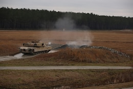 Marines with Tank Platoon, Company B, Ground Combat Element Integrated Task Force, fire the 120mm main gun of the M1A1 Abrams tank during a live-fire training exercise at Range SR-10, Marine Corps Base Camp Lejeune, North Carolina, Jan. 13, 2015. Marines with Tank Platoon conducted offensive and defensive engagements to prepare for an upcoming assessment at Marine Corps Air Ground Combat Center Twentynine Palms, California. From October 2014 to July 2015, the GCEITF will conduct individual and collective level skills training in designated ground combat arms occupational specialties in order to facilitate the standards based assessment of the physical performance of Marines in a simulated operating environment performing specific ground combat arms tasks. (U.S. Marine Corps photo by Sgt. Alicia R. Leaders/Released)
