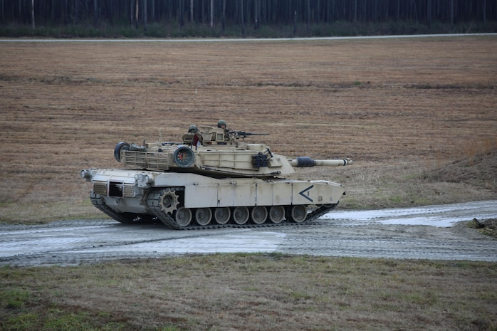 Marines with Tank Platoon, Company B, Ground Combat Element Integrated Task Force, maneuver to the firing position in an M1A1 Abrams tank during a live-fire training exercise at Range SR-10, Marine Corps Base Camp Lejeune, North Carolina, Jan. 13, 2015. Marines with Tank Platoon conducted offensive and defensive engagements to prepare for an upcoming assessment at Marine Corps Air Ground Combat Center Twentynine Palms, California. From October 2014 to July 2015, the GCEITF will conduct individual and collective level skills training in designated ground combat arms occupational specialties in order to facilitate the standards based assessment of the physical performance of Marines in a simulated operating environment performing specific ground combat arms tasks. (U.S. Marine Corps photo by Sgt. Alicia R. Leaders/Released)