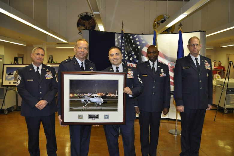 Master Sgt. Marco Trejo accepts his award for being named the Senior Non-Commissioned Officer of the Year from Chief of Staff, Nevada Air National Guard, Brig. Gen. David Snyder at the 2014 Outstanding Airmen of the Year Awards Banquet on Saturday. Left to right, Senior Enlisted Leader, Chief Master Sgt. Rick Scurry; Snyder; Trejo; Assistant Adjutant General, Brig. Gen. Ondra Berry; and the Adjutant General, Brig. Gen. William Burks.