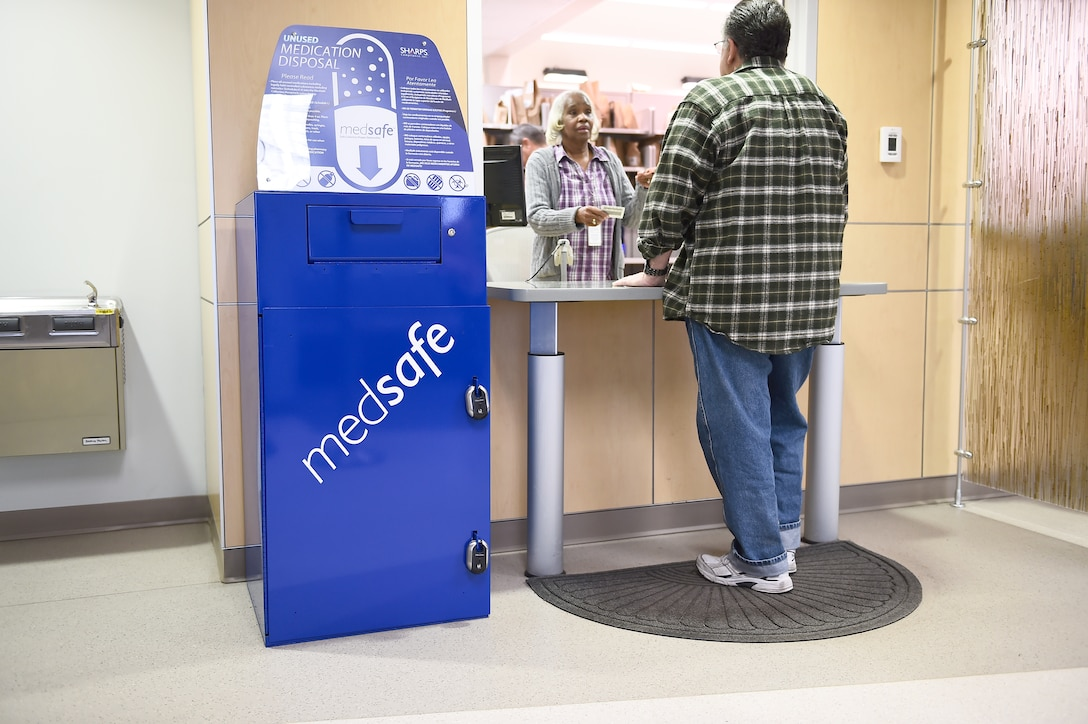 A blue MedSafe box is now located at the pharmacy on Buckley Air Force Base, Colo. The MedSafe box offers a safe way to dispose of old and unused medications to prevent misuse. (U.S. Air Force photo by Airman 1st Class Luke W. Nowakowski/Released)