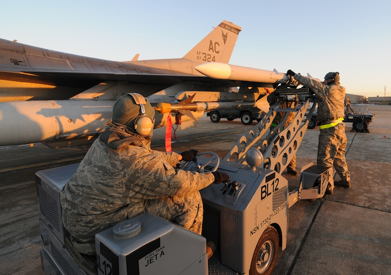 U.S. Air Force Airmen from the New Jersey Air National Guard's 177th Fighter Wing in Egg Harbor Township, N.J., unload munitions from an F-16C Fighting Falcon on Jan. 9, 2015. The Airmen participate in an aircraft generation exercise that test the readiness of the ground and flight crews. (U.S. Air Force photo by Airman 1st Class Amber Powell/Released)
