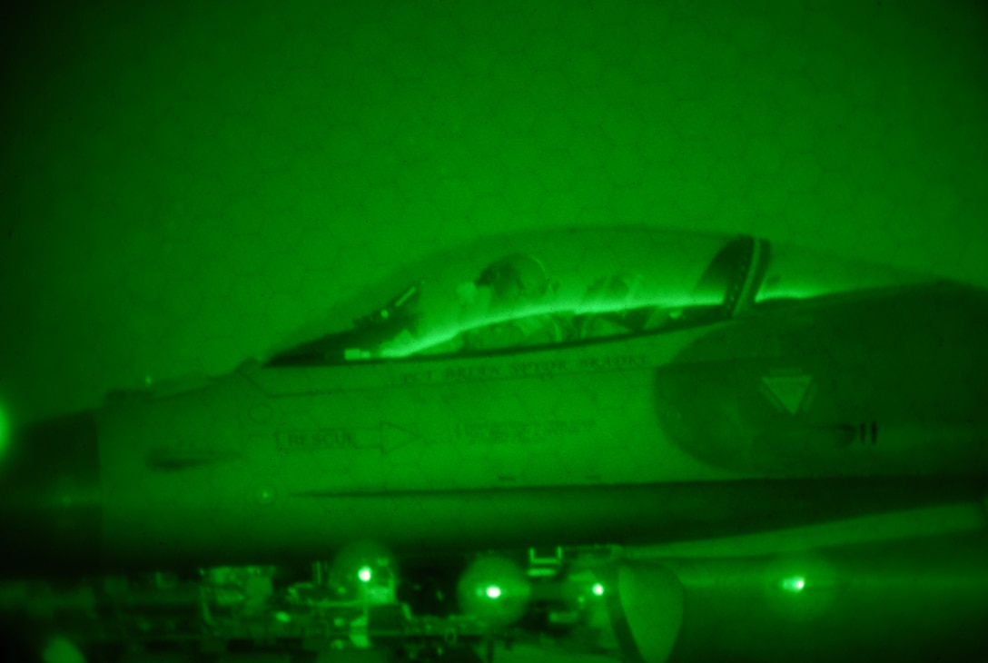 A U.S. Air Force F-16 pilot from the New Jersey Air National Guard's 177th Fighter Wing in Egg Harbor Township, N.J., prepares for takeoff on Jan. 9, 2015, as seen by a night vision lens. Pilots and maintainers worked through winter cold temperatures while participating in a training exercise that test the readiness of the wing. (U.S. Air Force photo by Airman 1st Class Amber Powell/Released)
