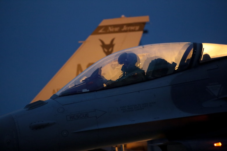 A U.S. Air Force F-16 Fighting Falcon pilot from the 177th Fighter Wing readies his aircraft for a training mission early in the morning at Atlantic City Air National Guard Base, N.J, Jan. 9, 2015. Airmen from the 177th Fighter Wing took part in JAN ME EX 15-01, a mission employment exercise that tested the Wing's sortie generation capabilities. (U.S. Air National Guard photo by Tech. Sgt. Matt Hecht/Released)