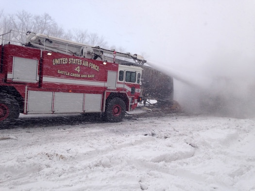 "Michigan Air National Guard firefighters from the 110th Attack Wing, Battle Creek Air National Guard Base, respond to a multi-vehicle crash on the I-94 expressway near the base, Jan. 9, 2015. The Air National Guard is ""Always on Mission"" and Michigan Airmen and equipment demonstrated this capability by assisting civil authorities to protect life and property damage. Photo by Airman 1st Class Bush McCarthy, 110th Civil Engineer Squadron/Released)."