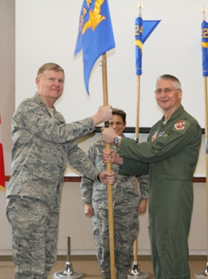 Maj. Gen. Verle Johnston, Commander, New York Air National Guard, passes the 224th Air Defense Group to Col. Wade Dewey during a January 10 activation ceremony.